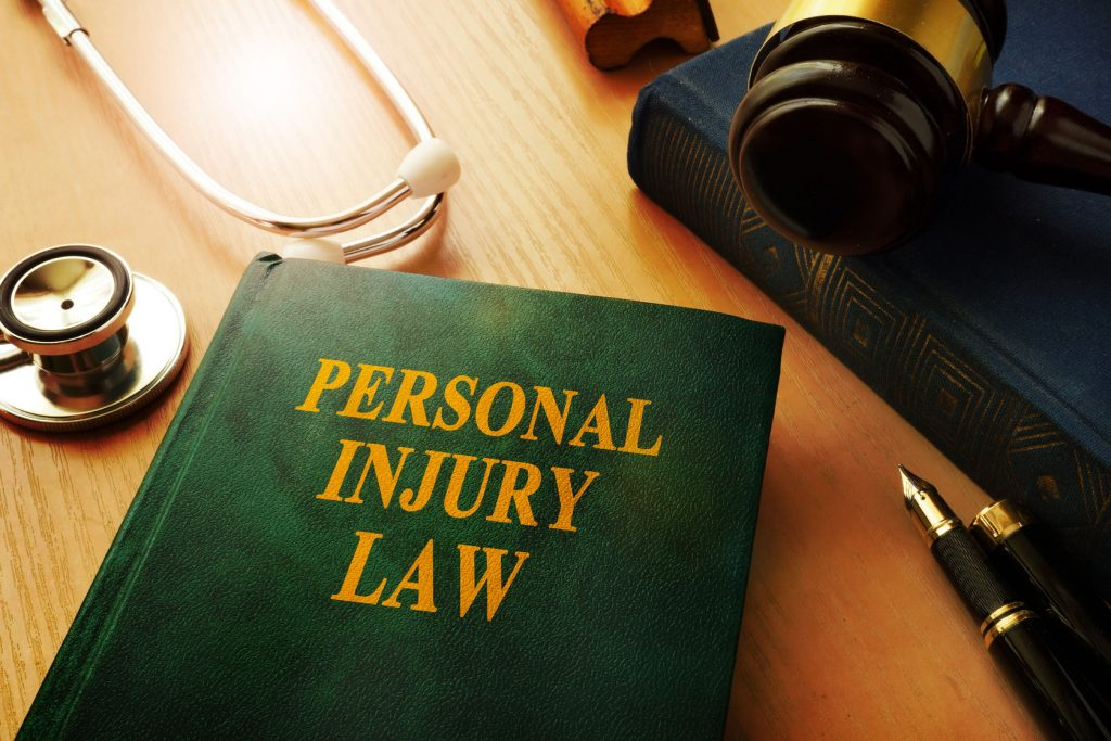 79824193 - personal injury law book on a table.